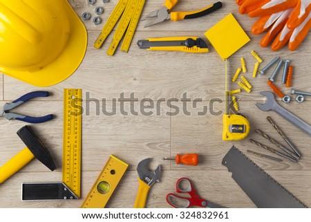 Work Tools frame on wood background - stock photo