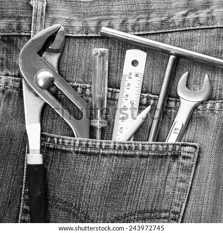 work tools in jeans pocket. bw filter
