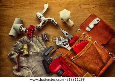 Work tools on wooden worktable. - stock photo