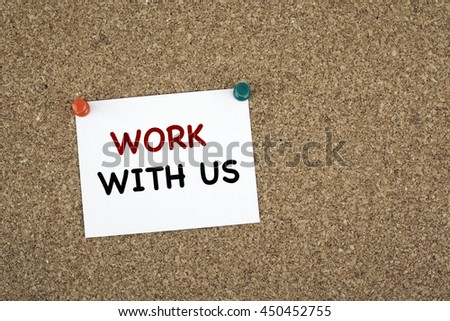 Work with us. Sticky note on cork board - stock photo