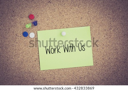 Work With Us written on sticky note pinned on pinboard - stock photo