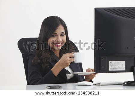 work woman in front of the computer relaxing - stock photo