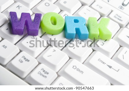 Work word made by colorful letters on keyboard