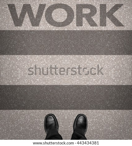 Work written on zebra crossing with business man shoes, overhead view - stock photo