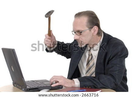 Workaholic,angry  businessman, boss working on  laptop. Business, corporate, stress concept.