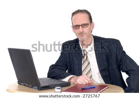 Workaholic, pensive looking businessman, boss working on  laptop. Business, corporate concept.