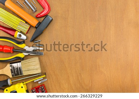 Workbench with different tools on wooden background - stock photo