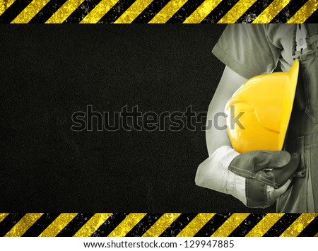 Worker and dark texture in background. Concept of OSH (occupational safety and health) - stock photo