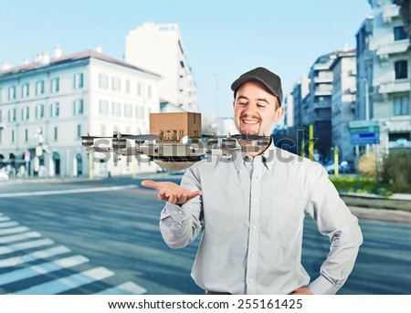 worker and modern drone delivery - stock photo
