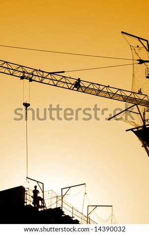 worker and sunset. under construction, working protection. - stock photo