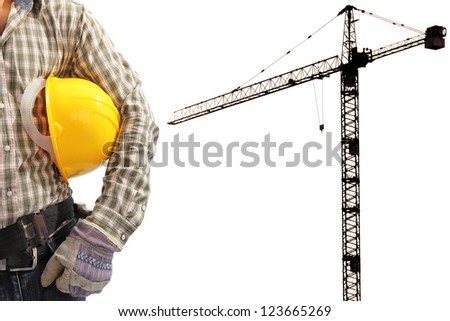 Worker and the silhouette construction tower crane in background with space for your text - stock photo