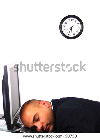 Worker asleep on his keyboard - stock photo