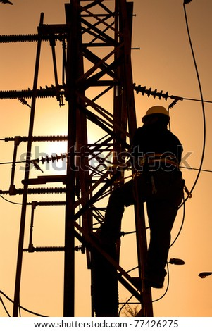 Worker at an electric substation - stock photo