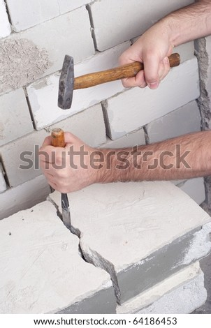 worker at building lot with  hammer