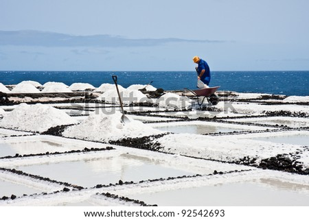 Worker at salt extraction La Palma - stock photo