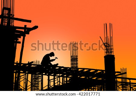 Worker black silhouette in construction site - stock photo