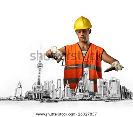 worker building a city - stock photo