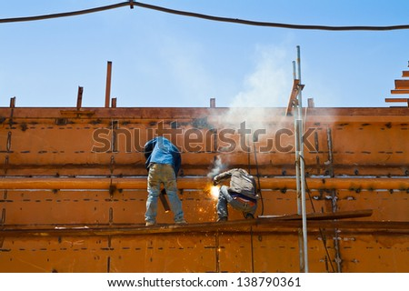 Worker building ship - stock photo