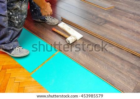 Real Carpenter Doing Laminate Floor Work Stock Photo