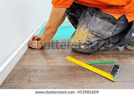Worker carpenter doing laminate floor work