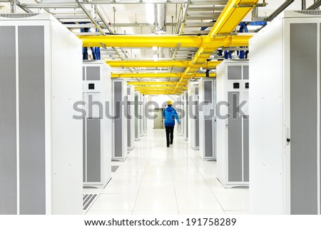 worker checking in the Telecommunication room - stock photo