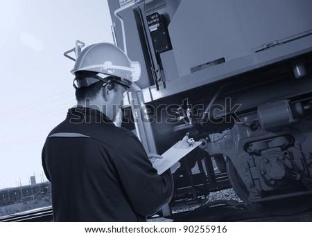 worker checking on train machine - stock photo