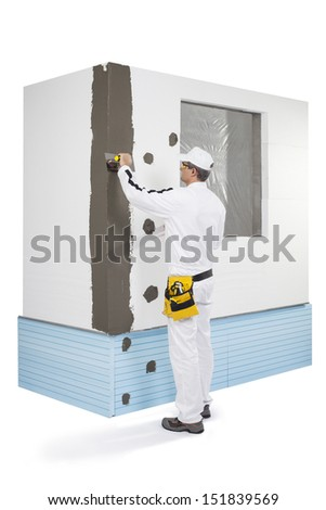 Worker coating a corner-lath with a putty - stock photo