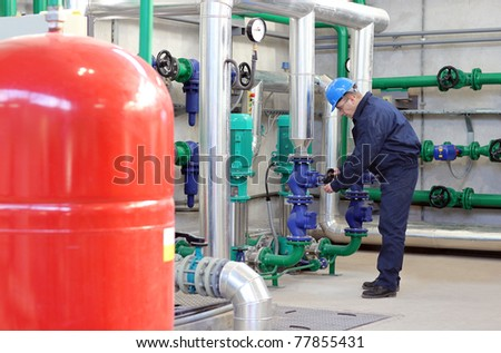 Worker control devices in Heating Plant - stock photo