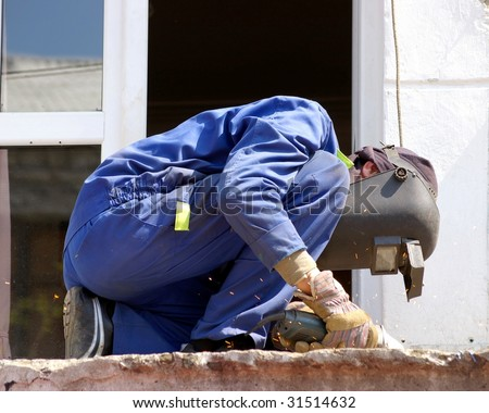 Worker cuts metal - stock photo