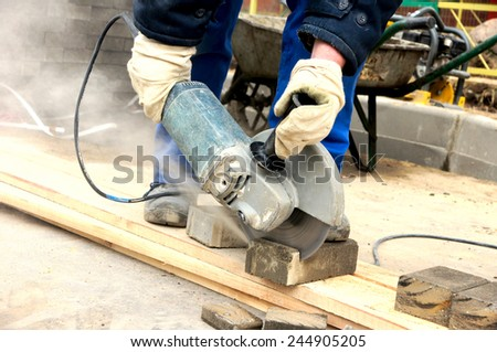 worker cuts the stone, view along the diagonal. - stock photo