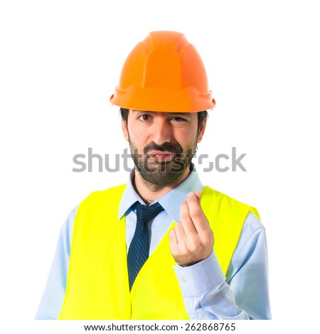 Worker doing a money gesture - stock photo