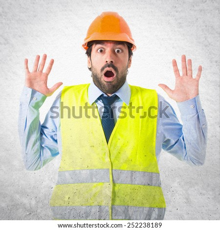 Worker doing surprise gesture - stock photo