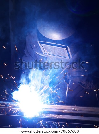 Worker executes the welding. Work composition - stock photo