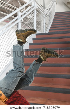 Worker falling down stairs in the workplace