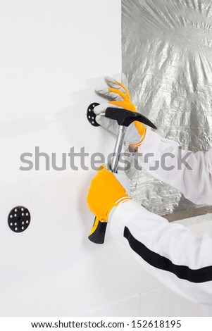 Worker fixing a dowel - stock photo