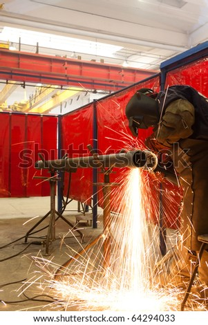 worker grind metal and sparks spread - stock photo