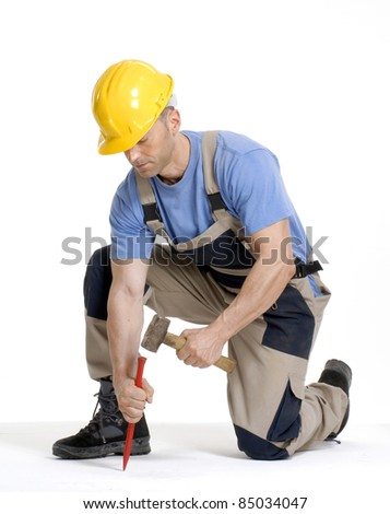 worker hammering.chisel on white background.