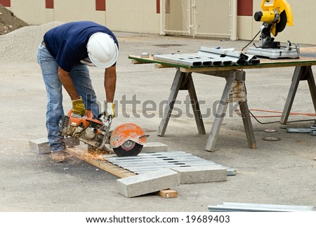 Worker Hand Sawing Metal Studs