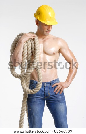 Worker holding a big rope on white background.