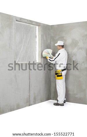 Worker holding a colour samples palette - stock photo