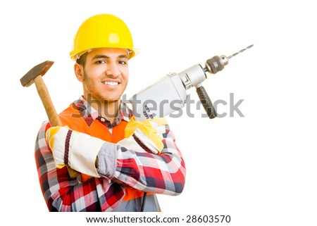 Worker holding a hammer and a drilling machine - stock photo