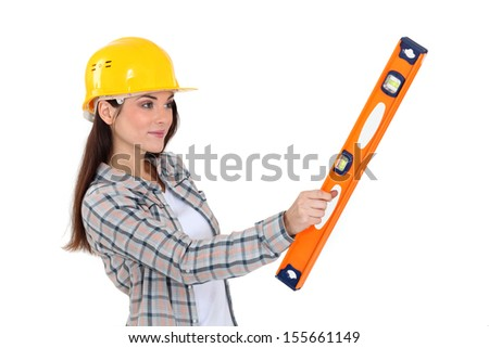 Worker holding a spirit level. - stock photo