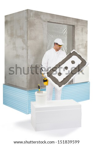 Worker holding an insulation panel coated with a lute - stock photo