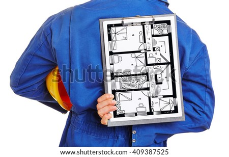 Worker holding floor plan of house on a clipboard behind his back - stock photo