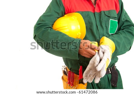 Worker holding helmet, isolated over white