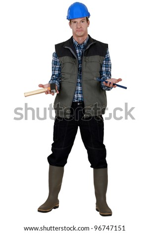 Worker holding tools