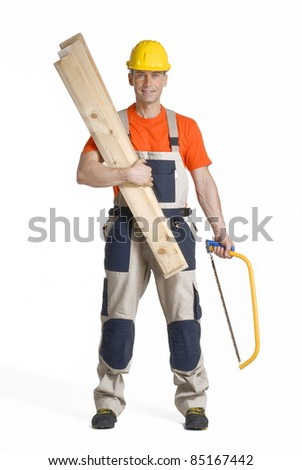 Worker holding wood boards and saw.