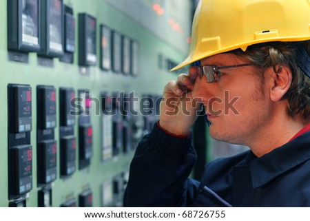 Worker in a Control Room - stock photo
