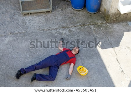 Worker in a faint after dramatic on-the-job injury  - stock photo