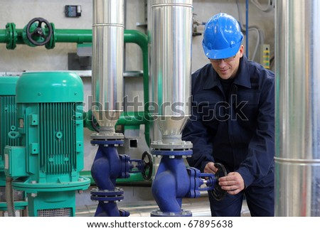 Worker in a Heating Plant - stock photo